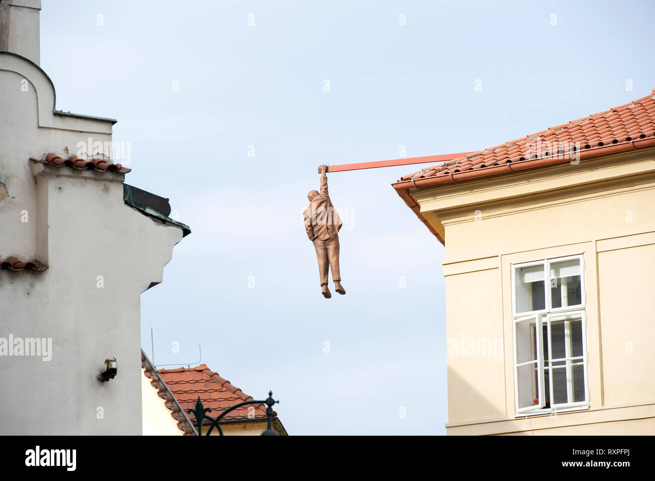 The 7 foot Sigmund Freud statue by artist David Cerny hanging above the streets of Old Town Prague (Praha), Czech Republic. - Stock Image