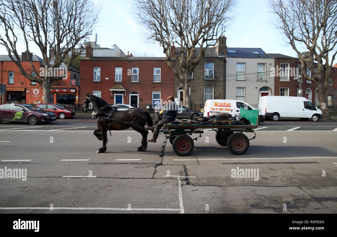irish traveller with horse and cart on north circular road Dublin Republic of Ireland europe Stock Photo