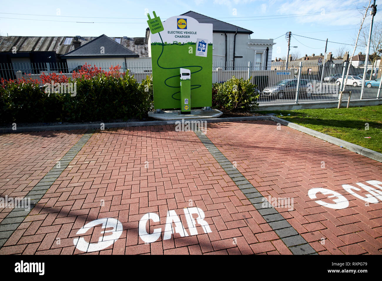 electric car charging point in the car park of a lidl supermarket in Dublin Republic of Ireland europe - Stock Image