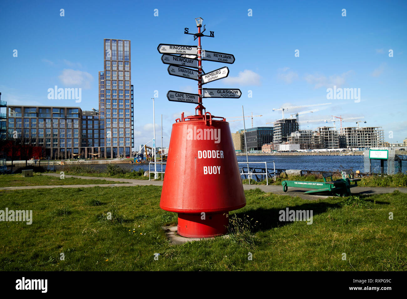 Dodder Buoy with direction signs and distance markers to various uk and world cities dublin docklands Dublin Republic of Ireland europe - Stock Image