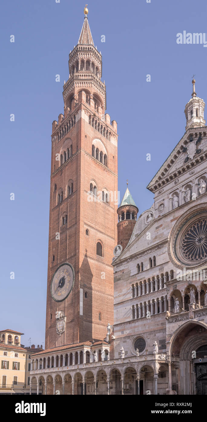 view of Romanseque Cathedral huge bell tower called 'Torrazzo' , shot in bright winter light at Cremona, Lombardy,  Italy - Stock Image