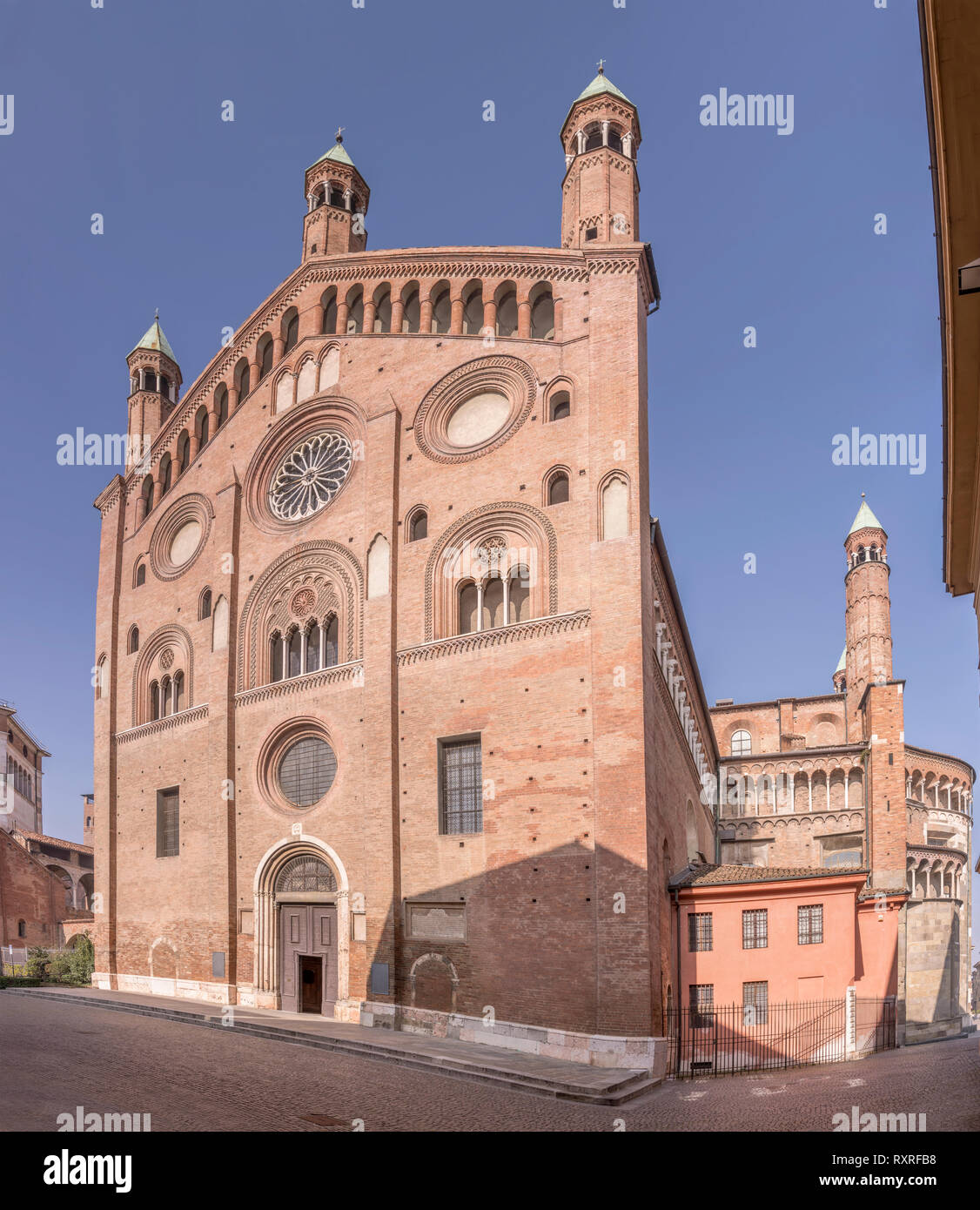 view of Romanseque Cathedral transept facade, shot in bright winter light at Cremona, Lombardy,  Italy - Stock Image
