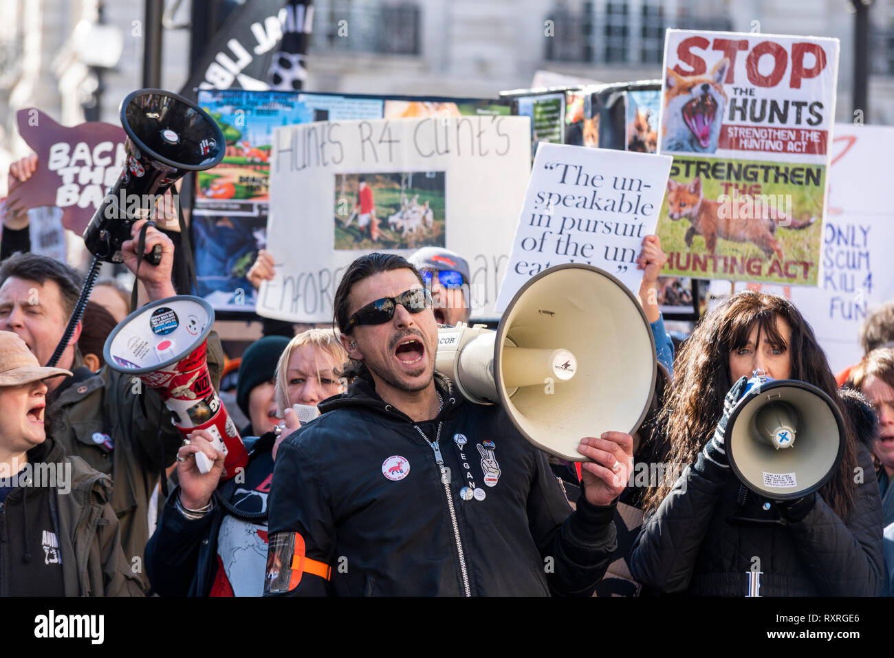 A protest march has taken place from Cavendish Square to Parliament Square, London, UK to protest against the lack of enforcement of the fox hunting ban. Protesters believe that hunts which take place following trails often end with the death of a fox, despite the ban - Stock Image