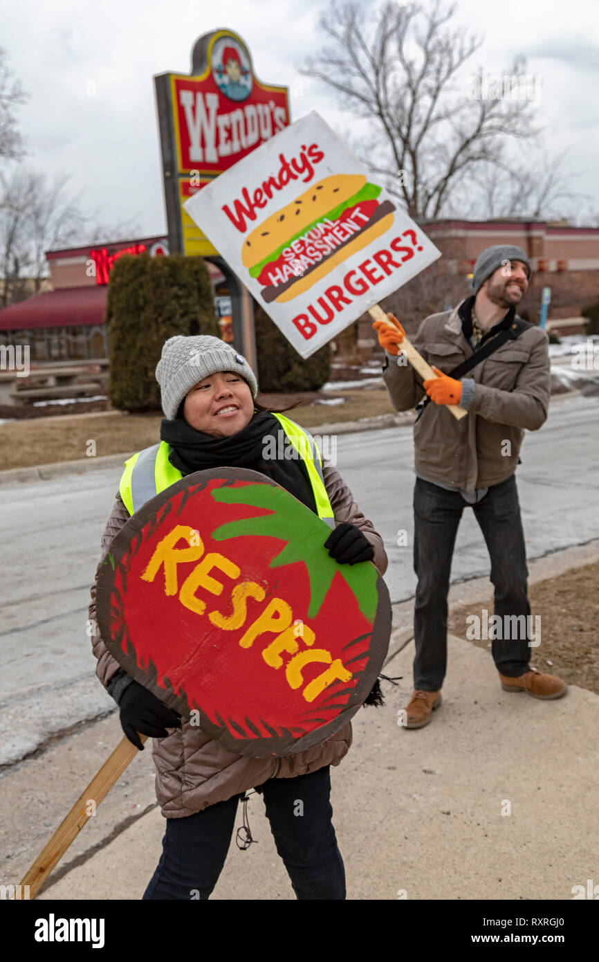 Ypsilanti, Michigan USA. 9th Mar 2019.  Members of the Coalition of Immokalee Workers and their supporters rally at a Wendy's fast food restaurant, asking the company to pay a penny a pound more for the Florida tomatoes it buys. The additional penny would go to improve wages for Florida farmworkers. The rally was part of a tour, targeting Wendy's stores in several university towns. CIW wants the universities to end their relationships with Wendy's until the chain joins the Fair Food Program. Credit: Jim West/Alamy Live News Stock Photo