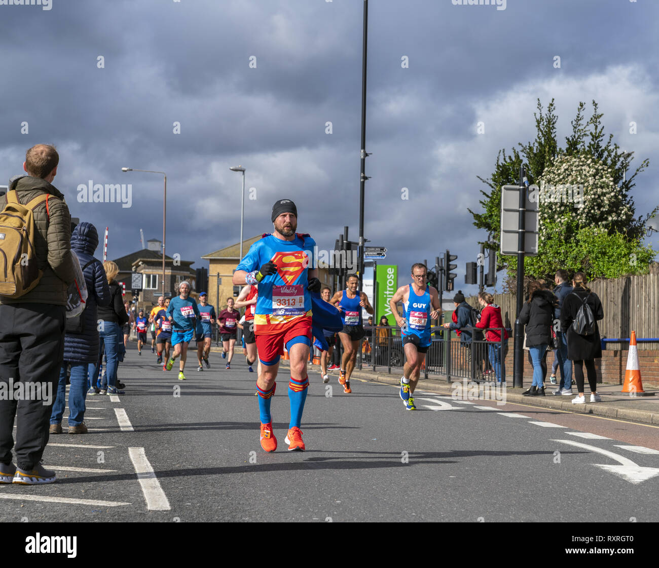 London, UK. 10th Mar 2019. An athletic man dressed in Superman costume competes in fundraising charity event Vitality Big Half marathon. Credit: AndKa/Alamy Live News Stock Photo