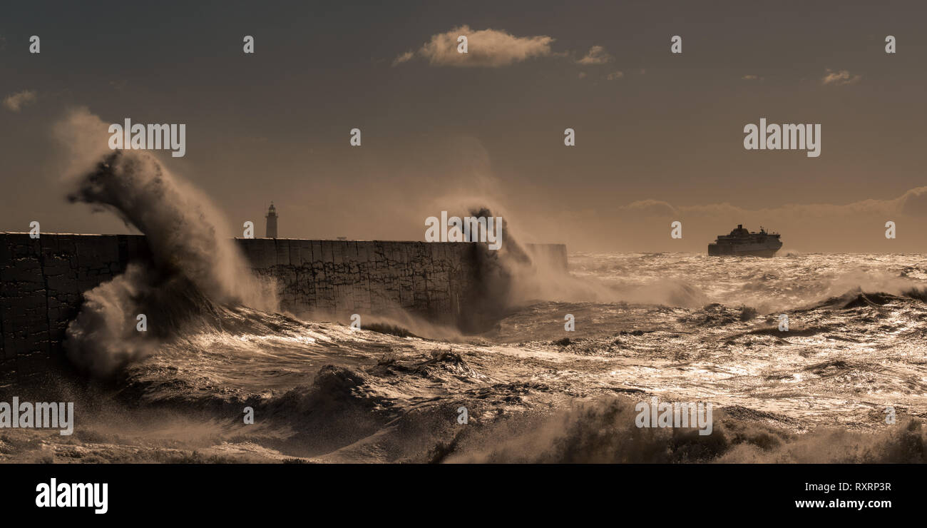 Newhaven, South Coast. 10th Mar 2019. UK Weather: Big waves hit the South Coast of Newhaven, East Sussex. Ferry leaving port of Newhaven Credit: Lloyd Lane/Alamy Live News Stock Photo