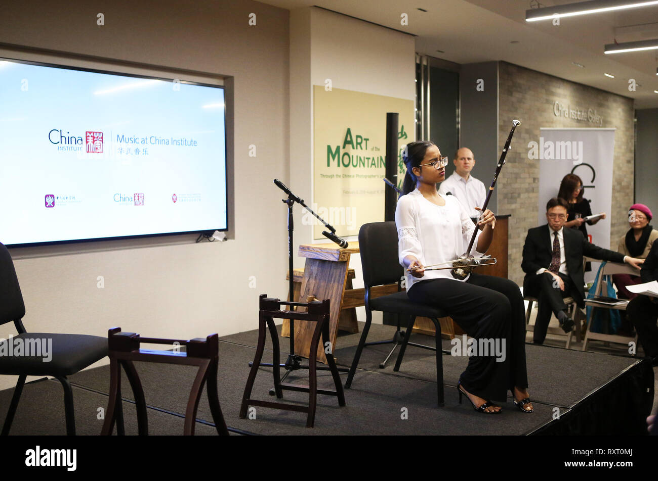 (190311) -- NEW YORK, March 11, 2019 (Xinhua) -- A student performs erhu solo 'Happily Ship Crops' during the launch ceremony of an educational program on traditional Chinese music at the China Institute's headquarters in New York, the United States, on March 10, 2019. The New York City-based China Institute launched a new educational program on traditional Chinese music in partnership with the Bard College Conservatory of Music (BCCM) on Sunday. Starting from spring 2019, the 'Music at China Institute' will offer classes on guqin, erhu, and guzheng, each with eight sessions. Founded in 1926, - Stock Image