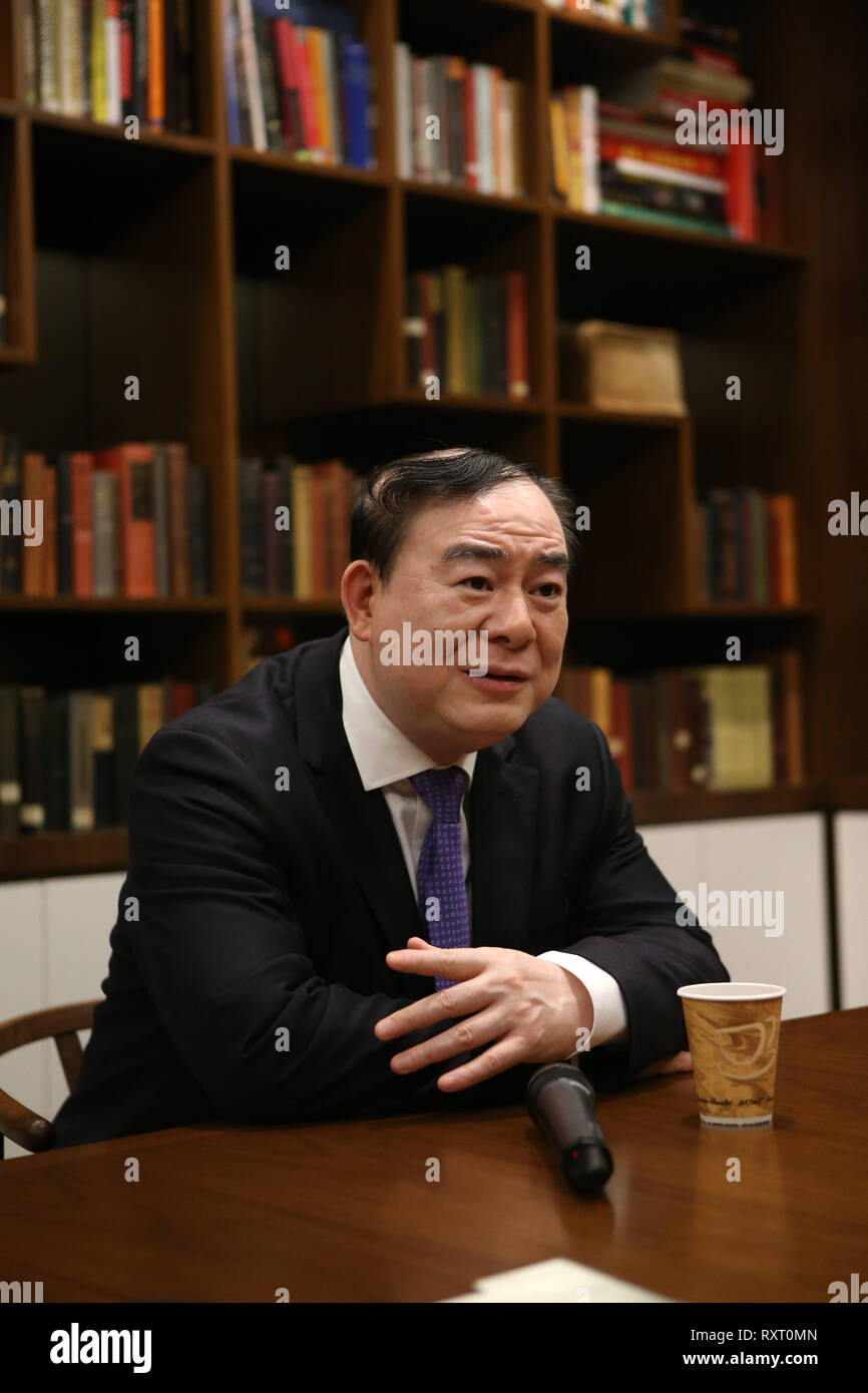 (190311) -- NEW YORK, March 11, 2019 (Xinhua) -- Yu Feng, president of the Central Conservatory of Music in Beijing, receives an interview with Xinhua prior to the launch ceremony of an educational program on traditional Chinese music at the China Institute's headquarters in New York, the United States, on March 10, 2019. The New York City-based China Institute launched a new educational program on traditional Chinese music in partnership with the Bard College Conservatory of Music (BCCM) on Sunday. Starting from spring 2019, the 'Music at China Institute' will offer classes on guqin, erhu, a - Stock Image