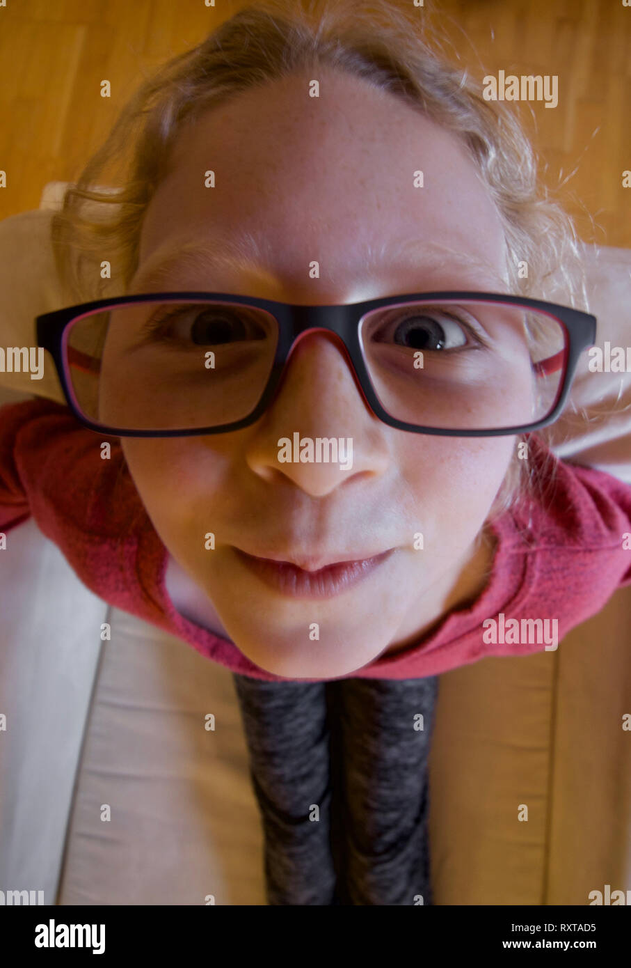 Girl up close with an ultrawide lens - Stock Image