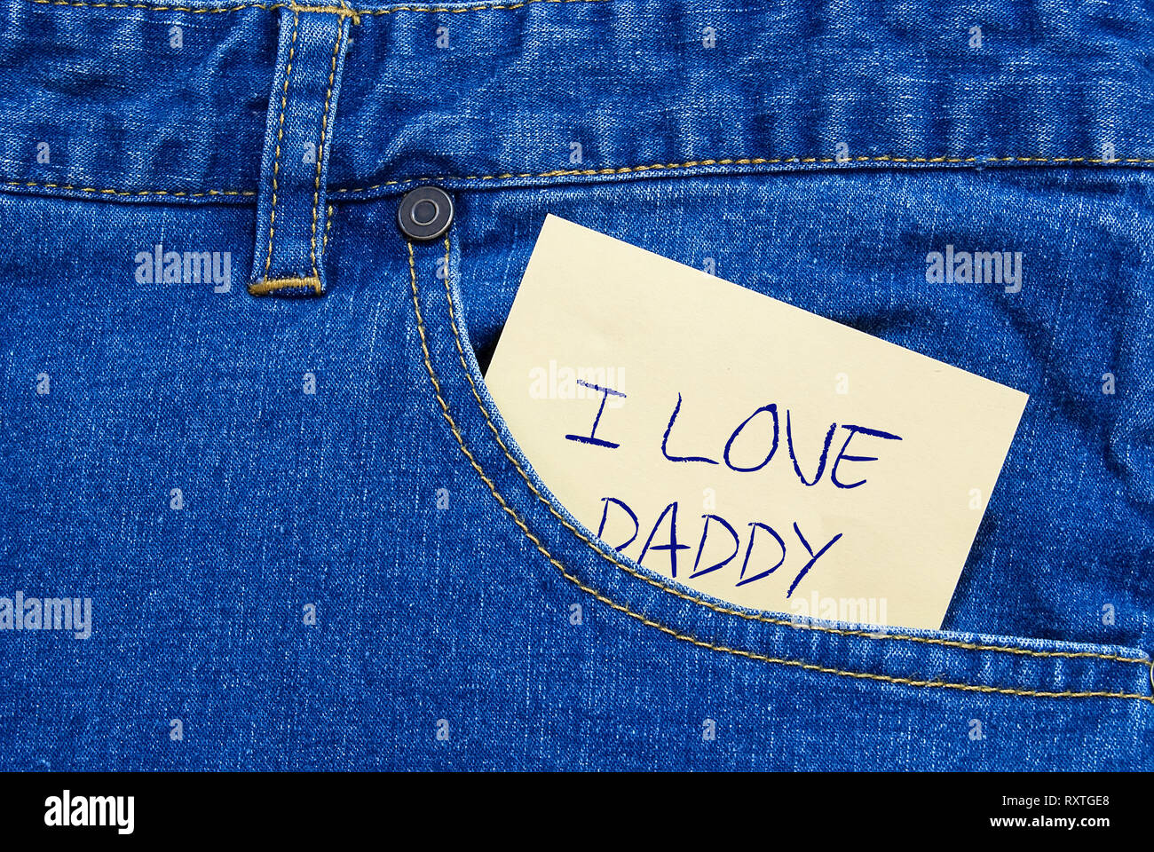 I love daddy written on a yellow posit a jeans pocket - Stock Image