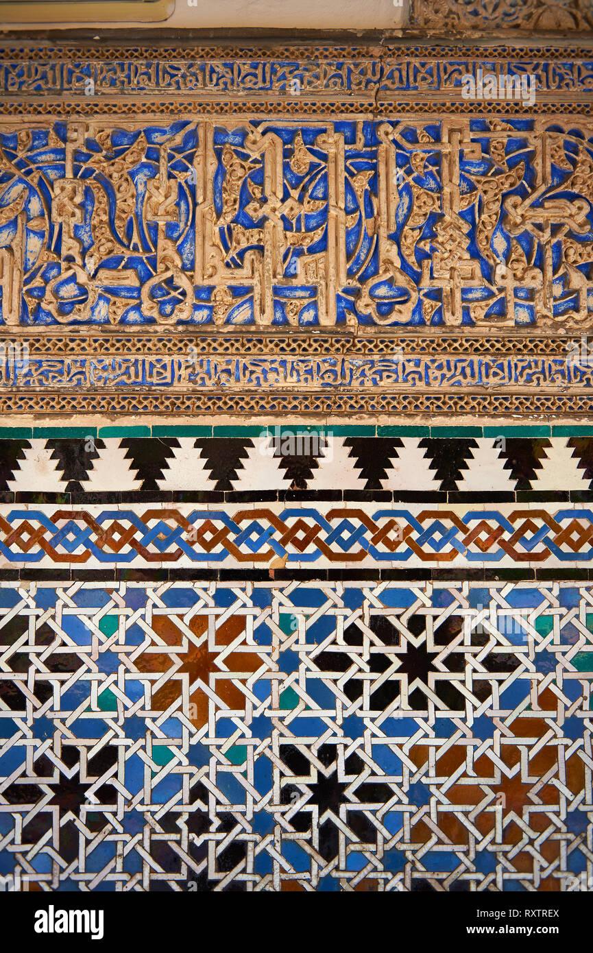 Arabesque Zellighe tiles with Mudjar plasterwork of the Alcazar of Seville, Seville, Spain - Stock Image