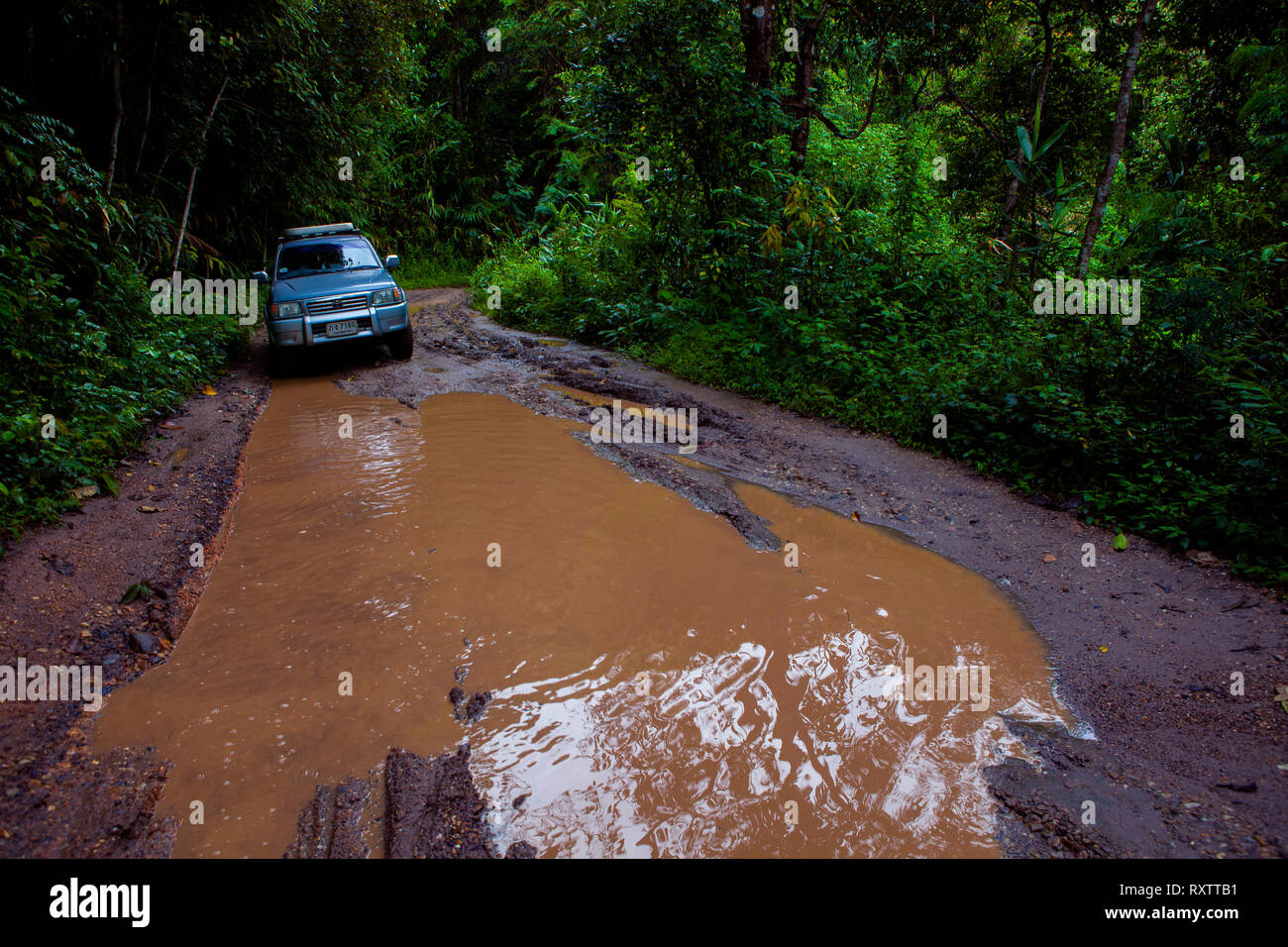 chiangmai thailand - september25,2013 : 4x4 suv car approach for passing offroad trail in high mountain of chiangmai province one of most popular trav - Stock Image