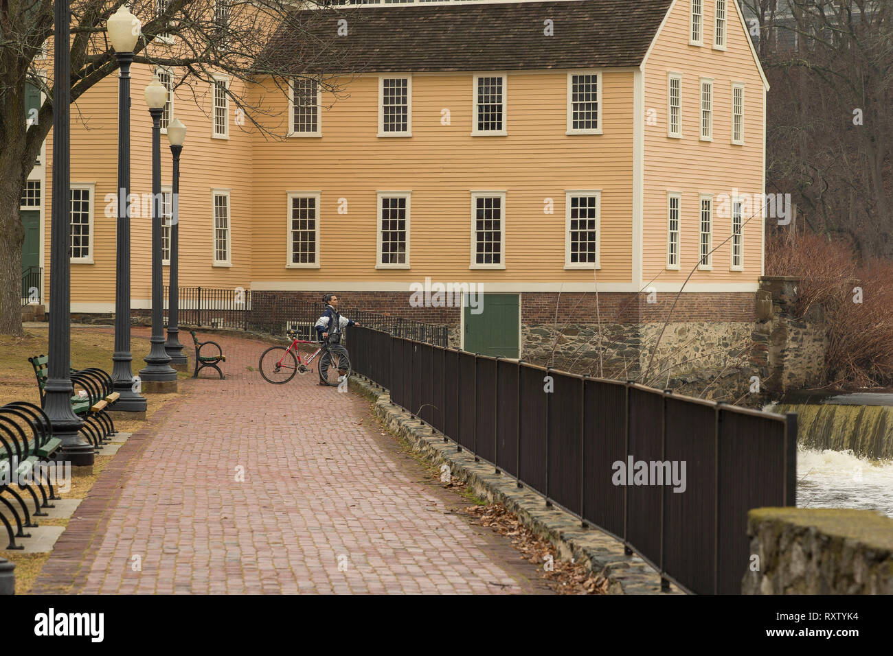 Carlos the cyclist at Slater Mill - Stock Image