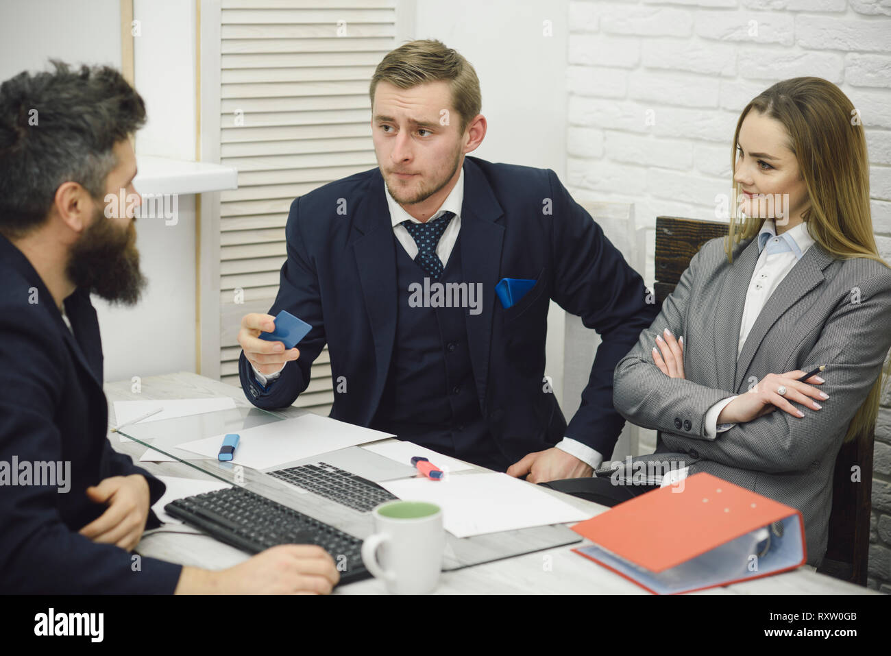 Business partners, businessmen at meeting, office background. Business crediting and investing concept. Businessman ask for investment. Bank workers - Stock Image