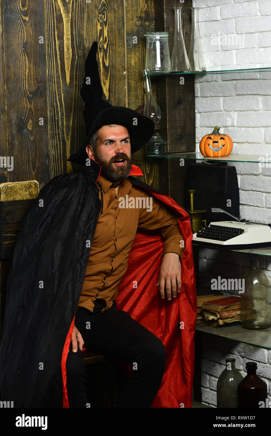 Halloween man in witch hat and cloak - Stock Image
