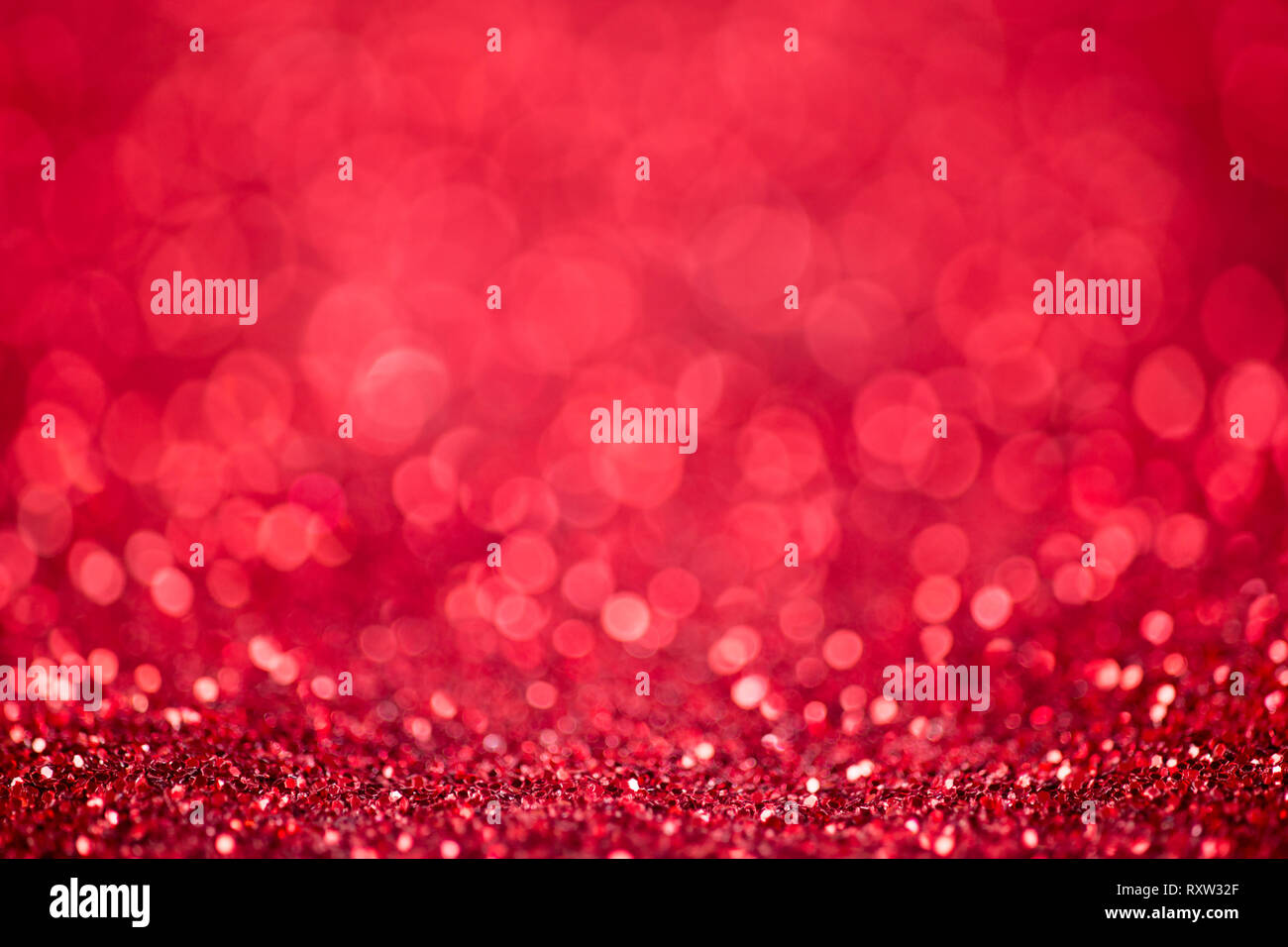 Red glitter christmas abstract background - Stock Image