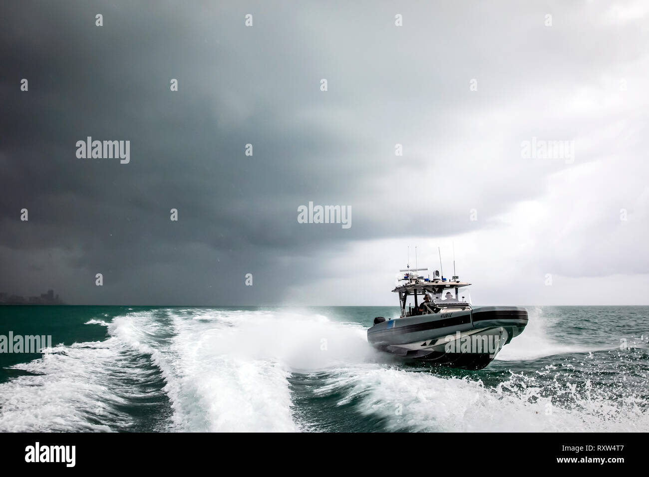 Marine Interdiction agents with U.S. Customs and Border Protection Air and Marine Operations (AMO) on board a Coastal Interceptor Vessel (CIV) with a maximum speed of 58 knots and range of 402 miles. See description for more information. - Stock Image