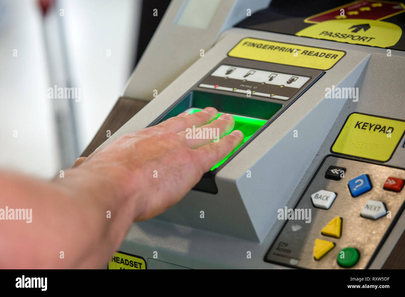 United States Customs and Border Protection (USCBP) scan the finger prints of arrivals at Miami International Airport in Miami, Florida. See more information below.; - Stock Image