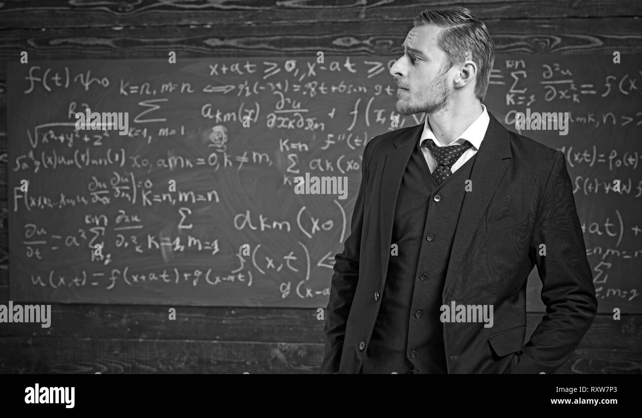 Intelligent man in suit at elite university. Side view blond guy with stylish hairstyle, beard and mustache - Stock Image