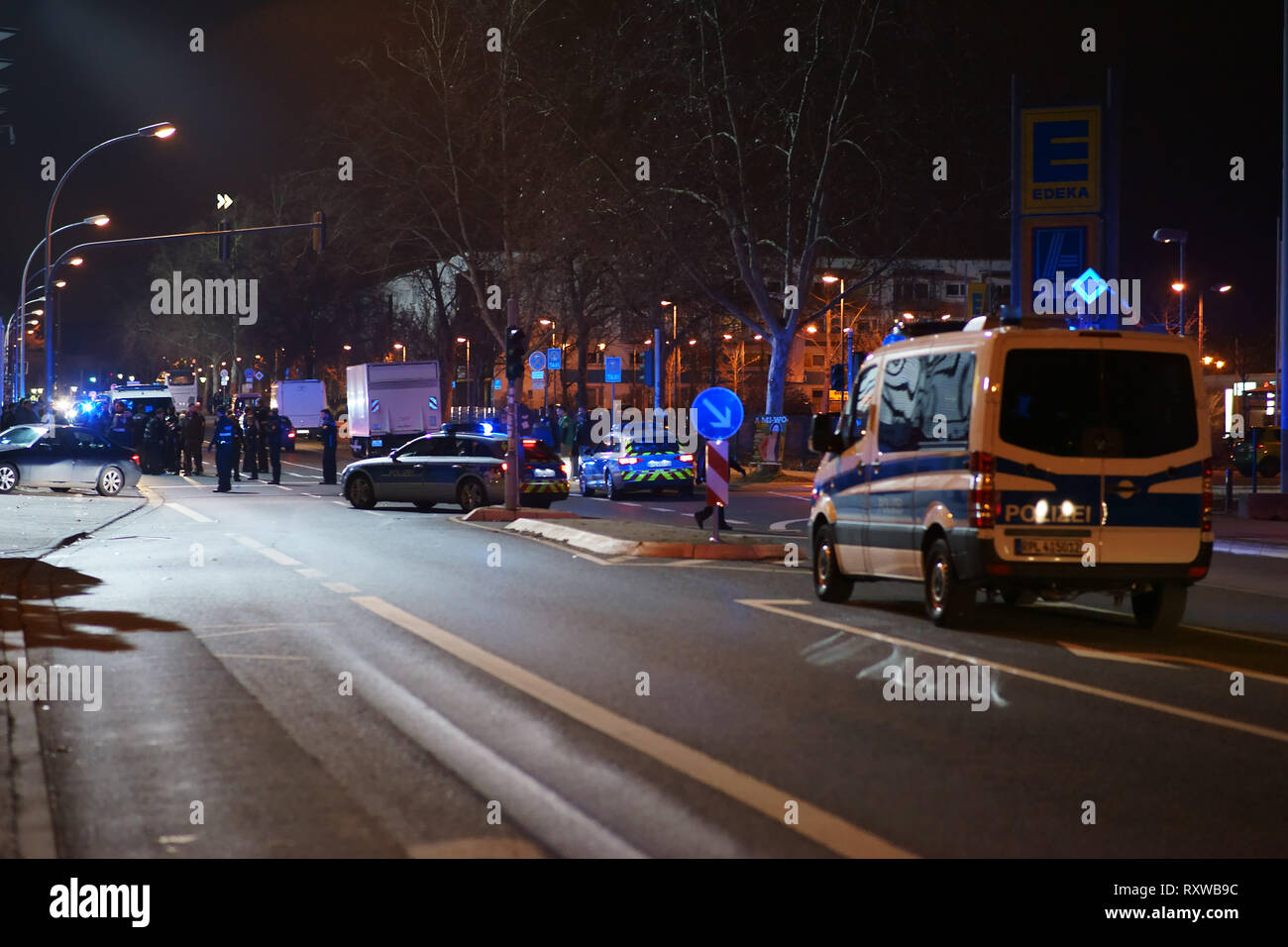 Mainz, Germany - March 01, 2019: Police cars with siren and blue lights blocking the street after a regional football match on March 01, 2019 in Mainz - Stock Image