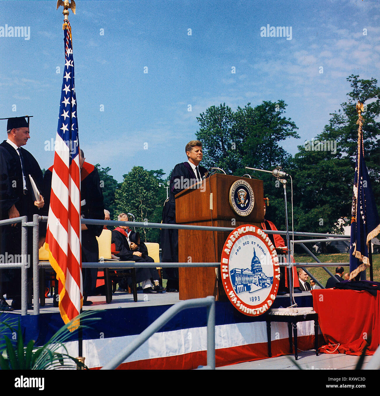 President John F Kennedy speaking at th Commencement Address at American University. Washington, D. C., American University, John M. Reeves Athletic Field. June 1963 - Stock Image