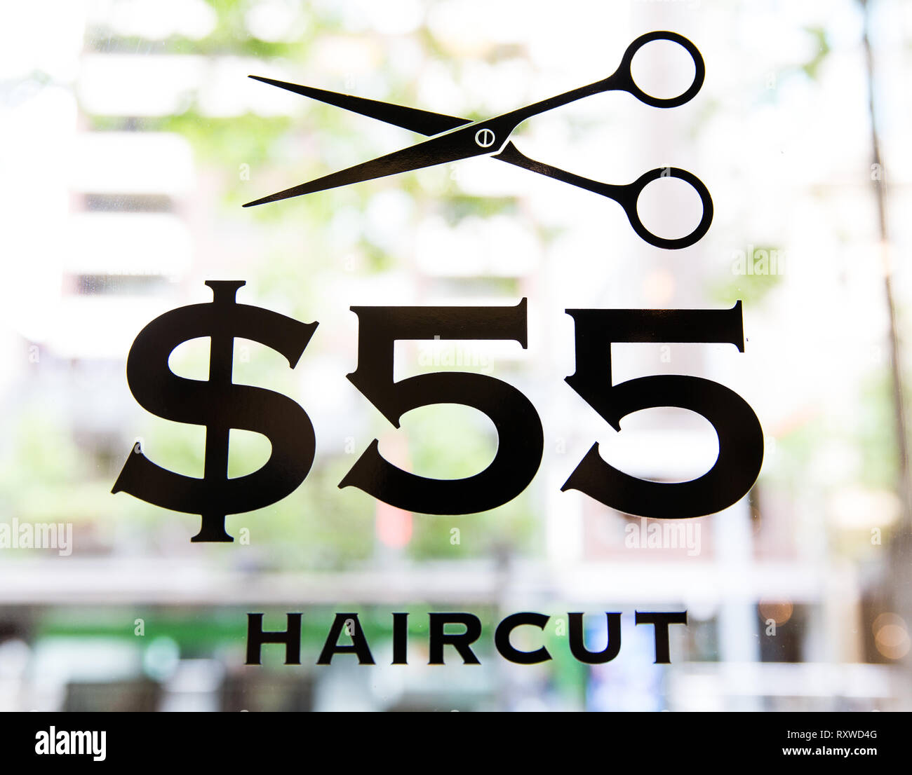 $55 Haircut sign, Melbourne - Stock Image
