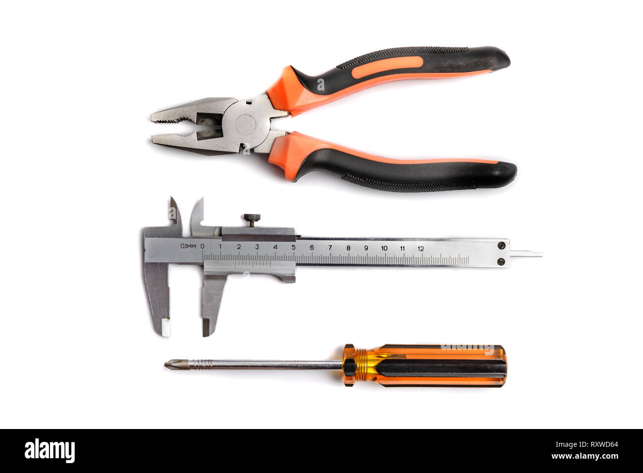 Calipers, pliers, screwdriver over white, tech support or repare concept - Stock Image