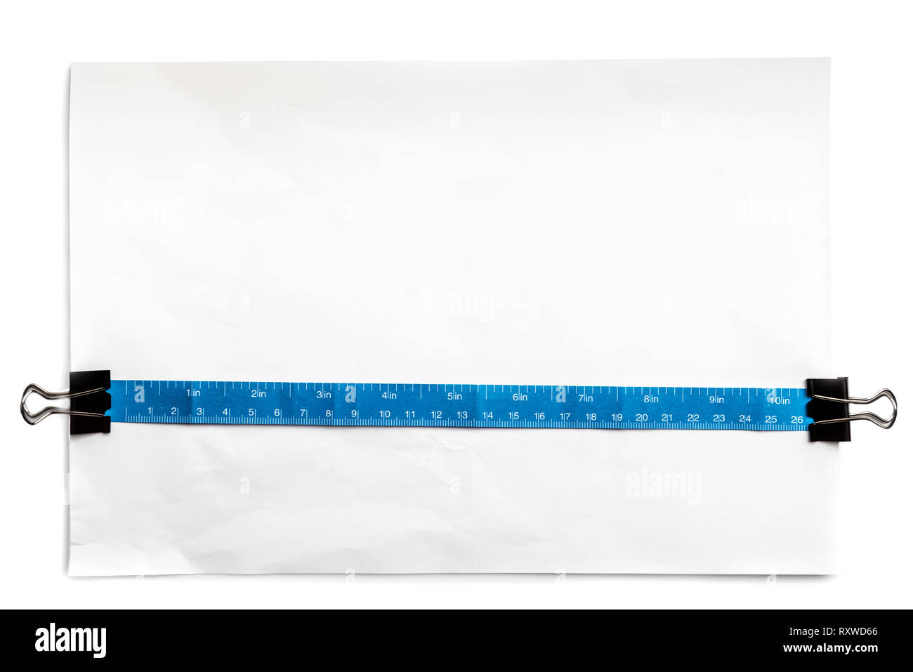 Simple paper tape measure inch and centimeter, over standart office white paper. Usefull for show object real size. - Stock Image