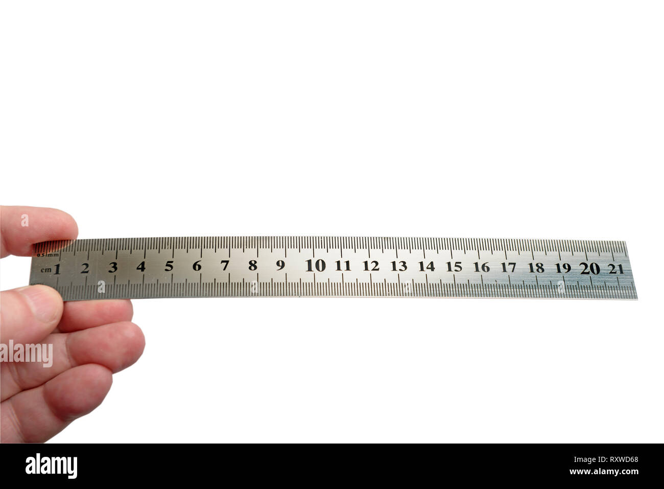 Metal ruler in man hand. Copy space for your object. Isolated on white background. Clipping path - Stock Image