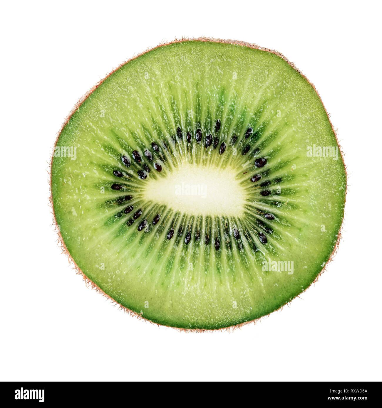 Slice of kiwi fruit macro isolated on white background - Stock Image