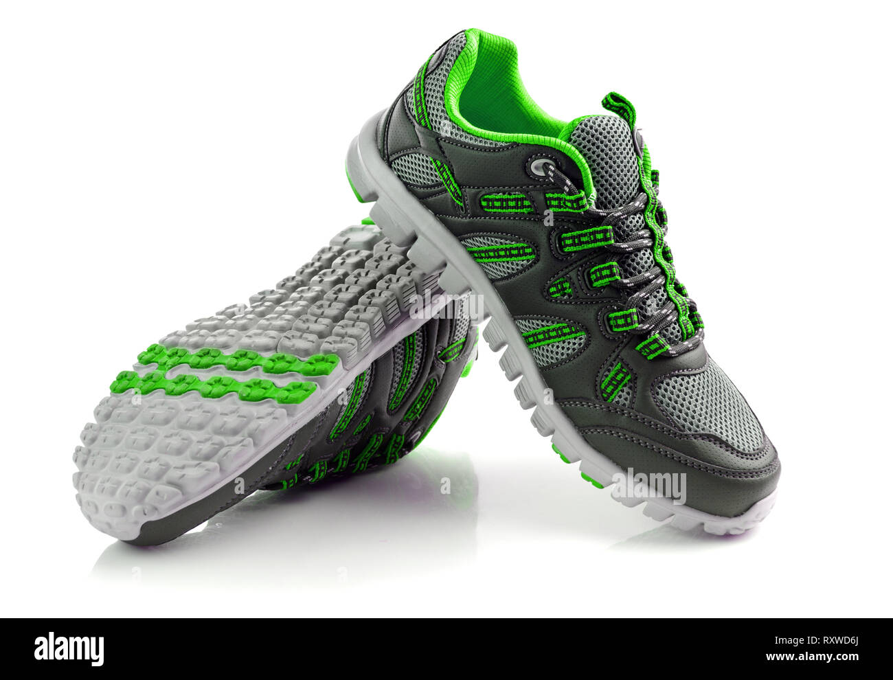 Unbranded modern sneakers sport shoes isolated - Stock Image