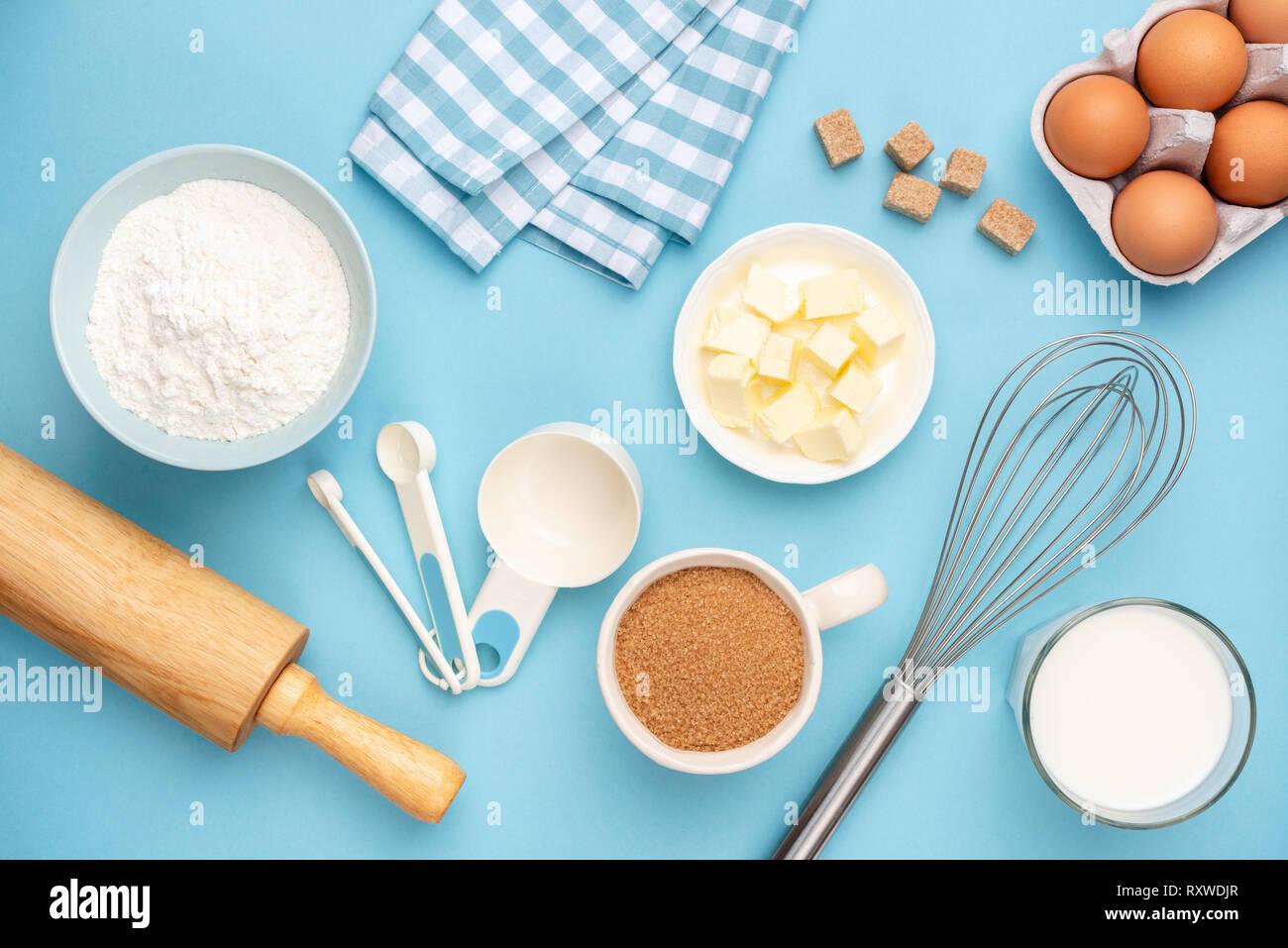 Kitchen Utensils And Baking Ingredients On Blue Background