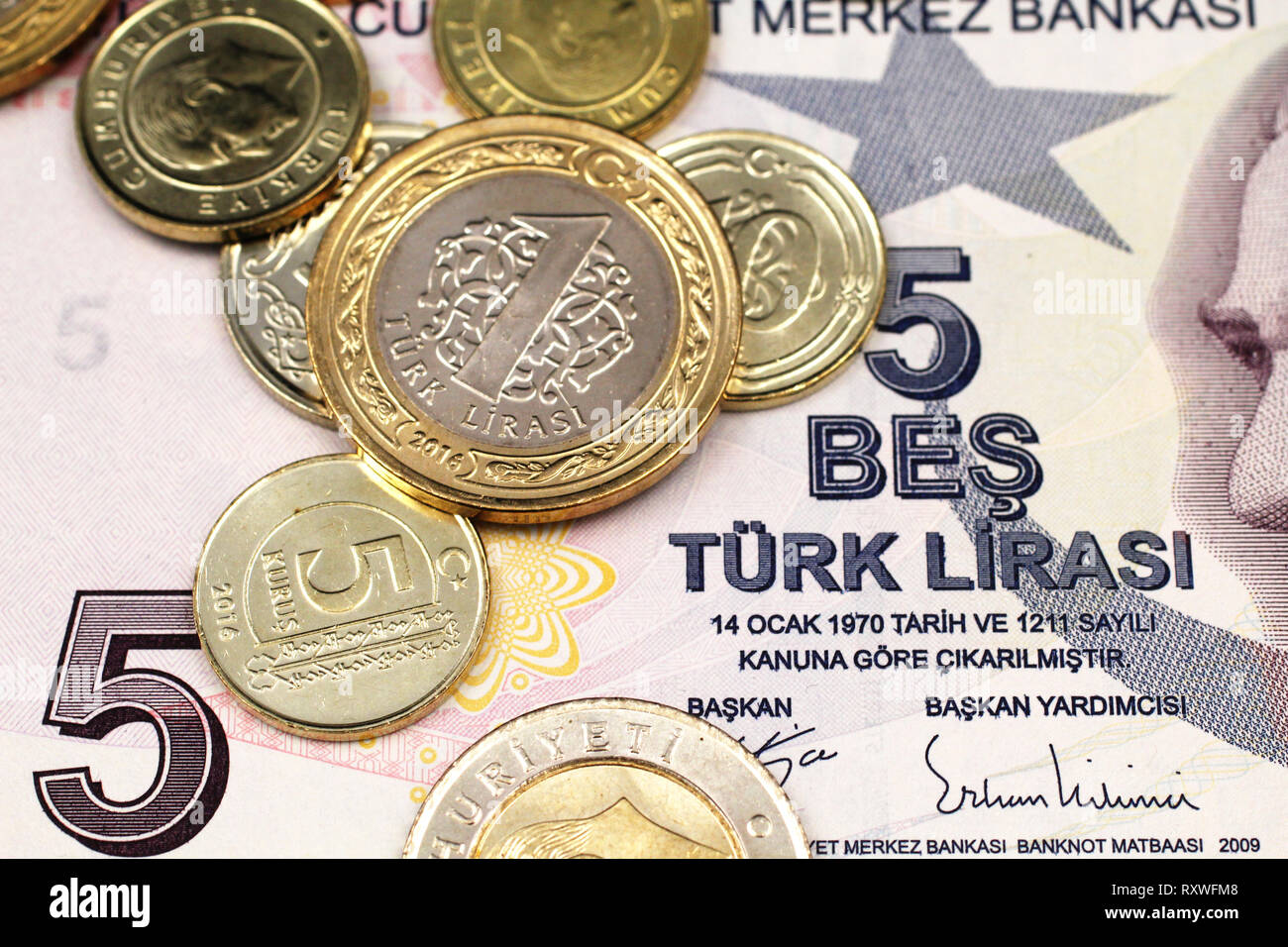 A macro image of an assortment Turkish coins close up on a purple, five Turkish lira bank note Stock Photo