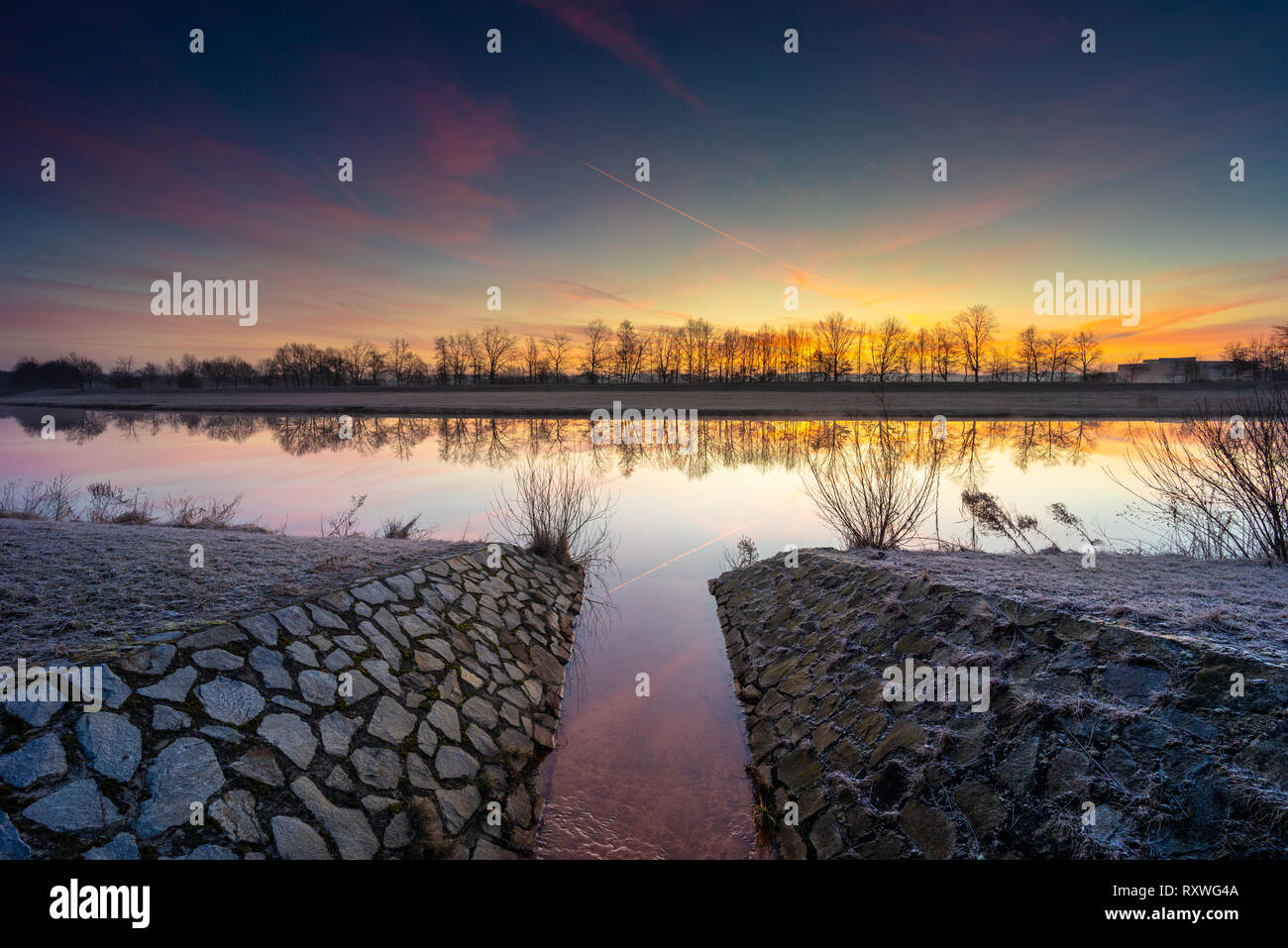 Frozen morning by the river under the sunrise heaven. Stock Photo
