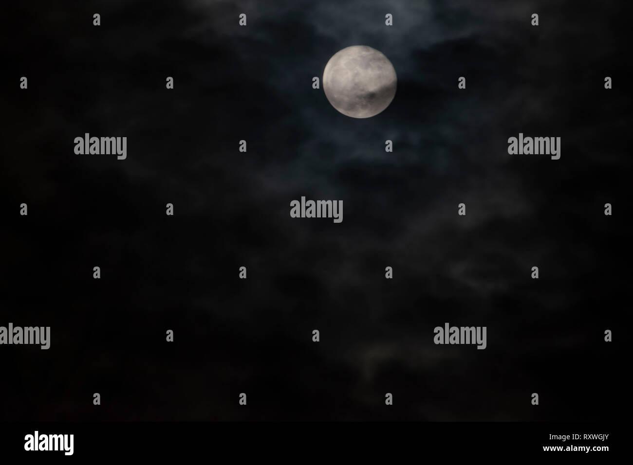 full moon on cloudy night Stock Photo