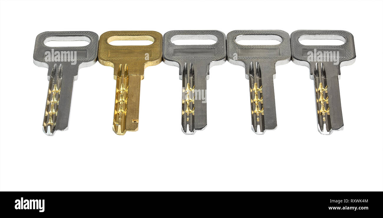 five keys in a row on a white background isolated closeup - Stock Image