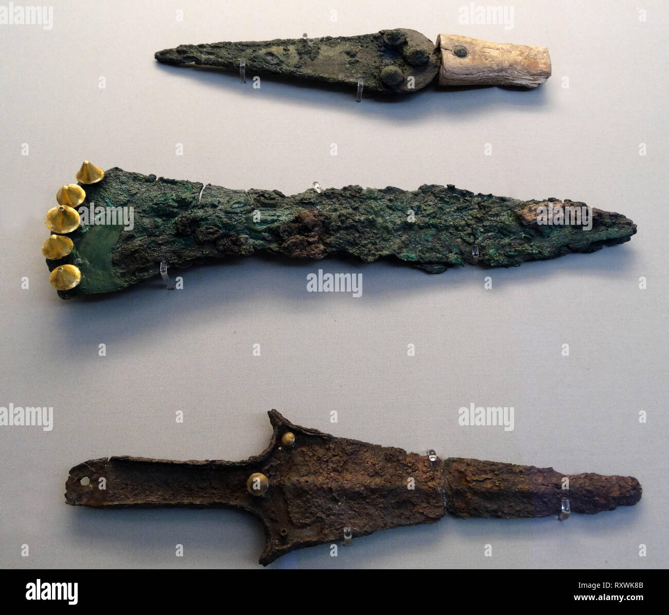 Dagger made from bronze with gilded attributes, from Circle A, a 16th-century BC royal cemetery, of the Bronze Age citadel of Mycenae in southern Greece. Characteristic of the early phase of the Mycenaean civilization - Stock Image