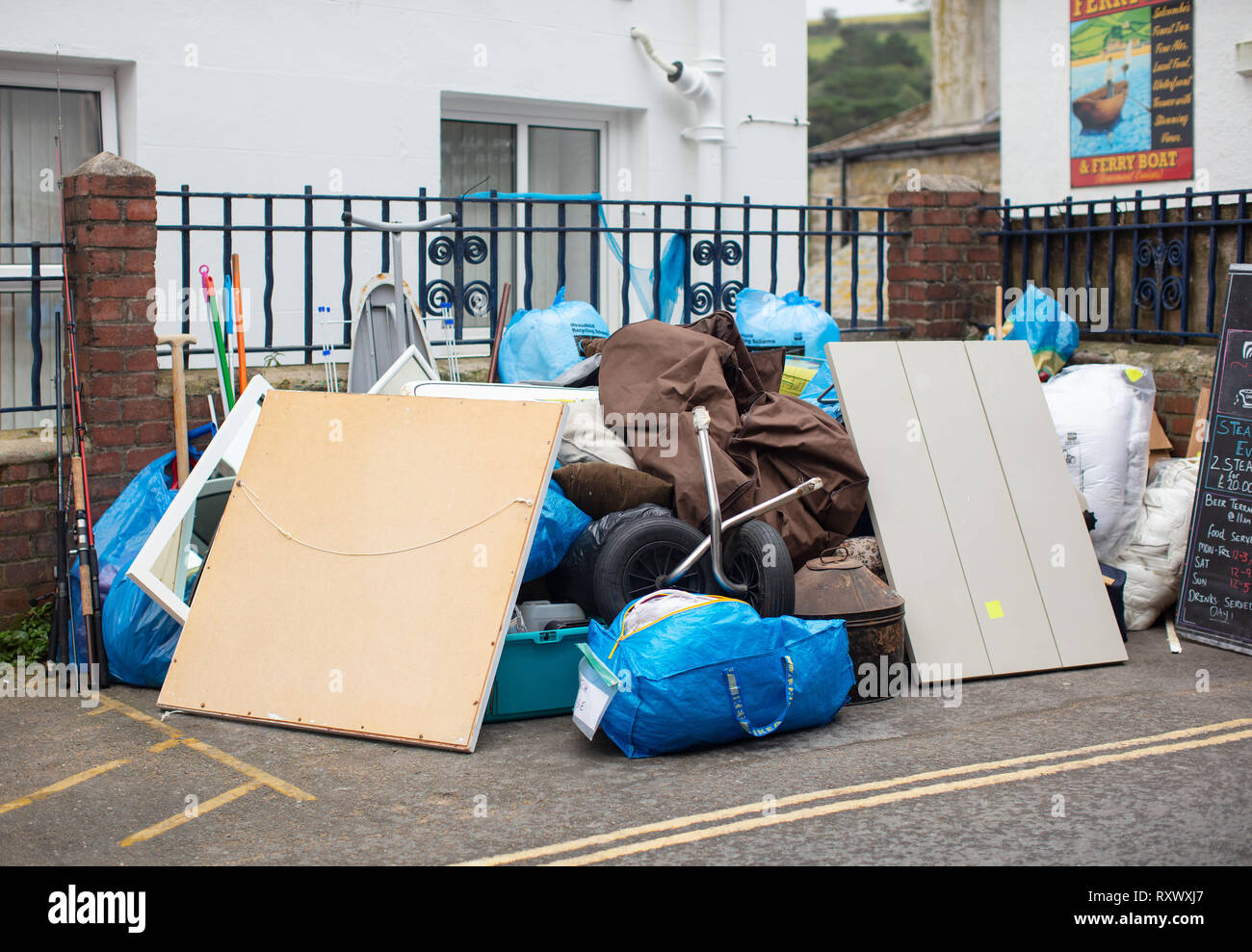A shot of a pile of possessions left on the street during a house move. - Stock Image