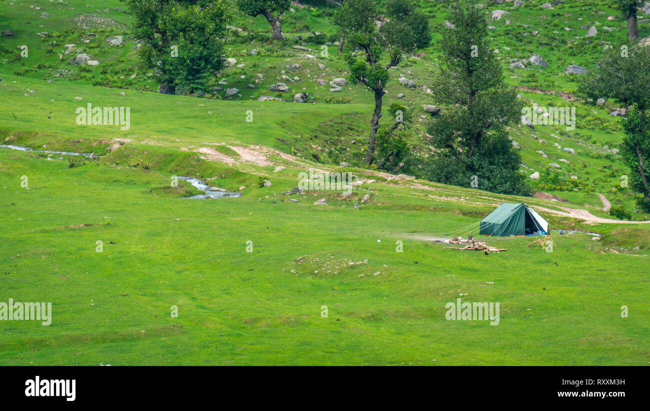 A camping tent set up by a group of campers in the meadows of Aru, Pahalgam in Kashmir, India - Stock Image