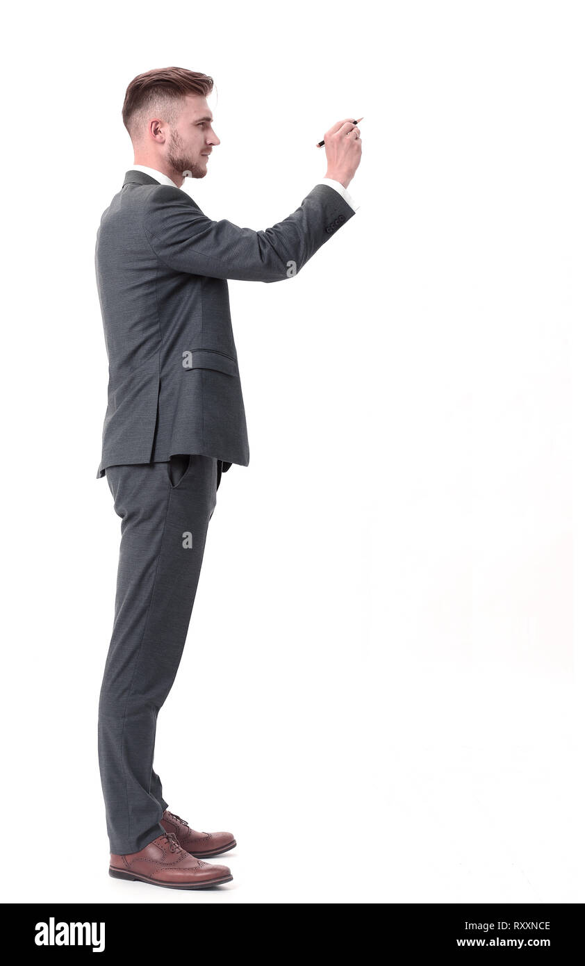 side view.businessman writing on an invisible Board. - Stock Image