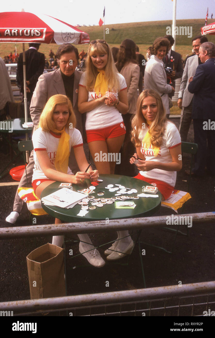 1974, sponsor's promotional girls at the 1974 Tour de France cycle race, British stage, Plymouth by-pass, England. - Stock Image
