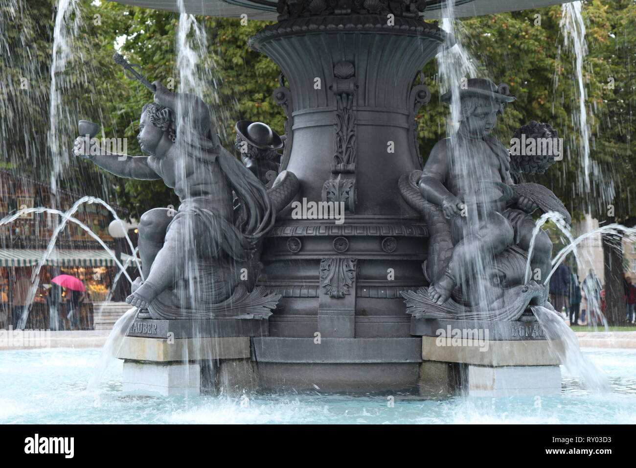 Fountain at Schlossplatz square , Neues Schloss (New Palace) in Stuttgart during a festival in October - Stock Image