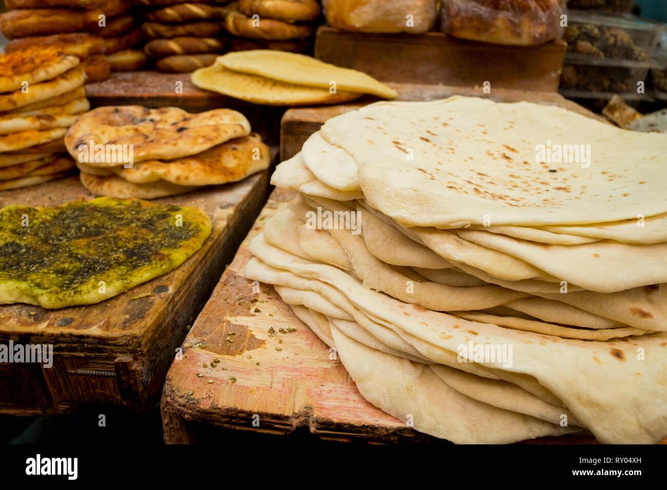 Fresh pita flat bread for sale at a Jewish market in Jerusalem, Israel. - Stock Image