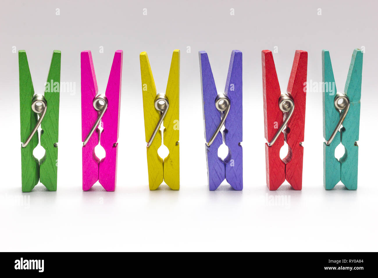Colorful clothespin. Multicolor Wooden clip set on white background. - Stock Image