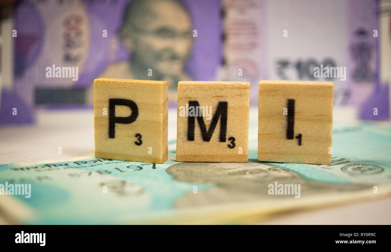 Maski,Karnataka,India - March 07,2019 : PMI or Purchasing Managers Index concept on wooden block letters on Indian Currency notes - Stock Image