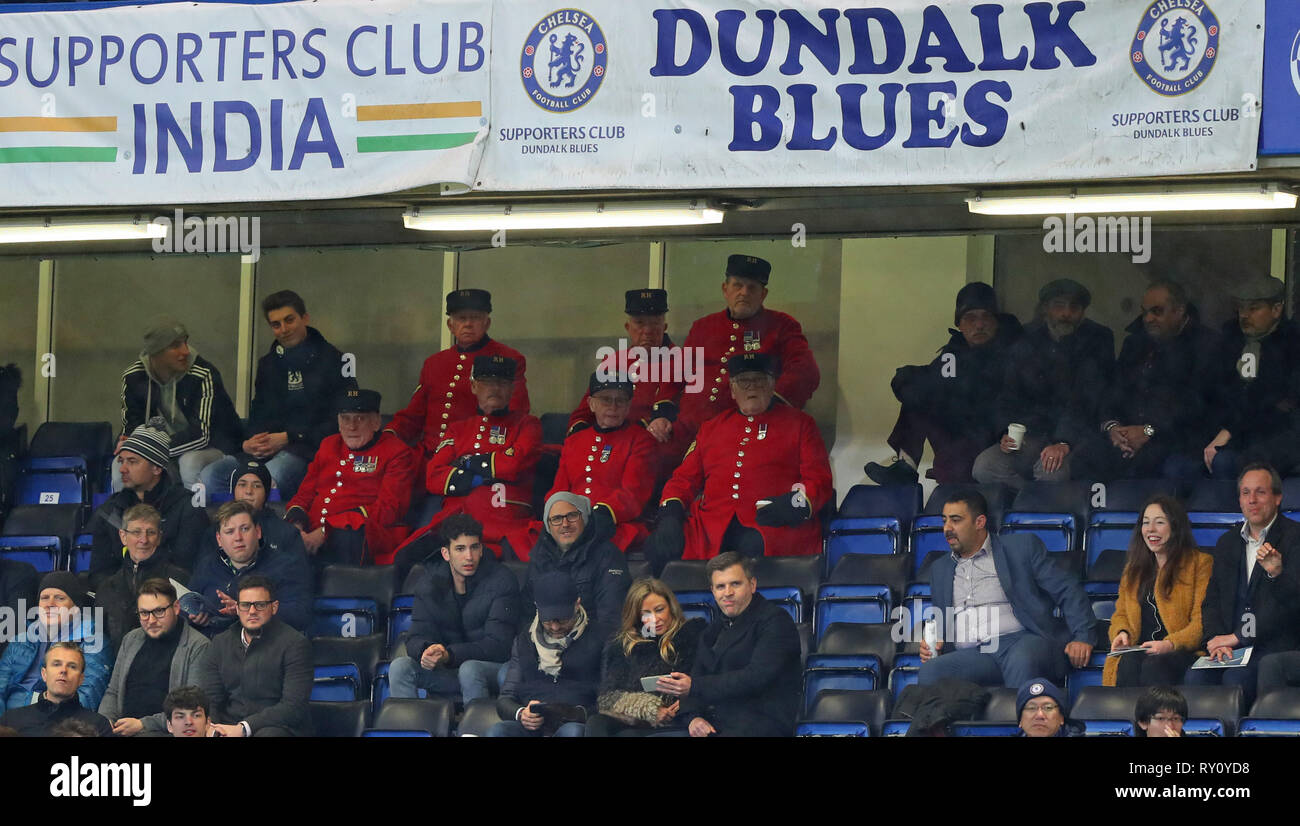 LONDON, ENGLAND - MARCH 7 2019: Members of the Royal Hospital Chelsea (Chelsea Pensioners) watching the Europa League match between Chelsea and Dynamo Kyiv at Stamford Bridge. - Stock Image