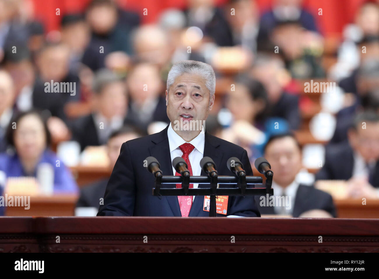 Beijing, China. 11th Mar, 2019. On behalf of the Central Committee of the Taiwan Democratic Self-Government League, Zhang Zexi, a member of the 13th National Committee of the Chinese People's Political Consultative Conference (CPPCC), delivers a speech at the fourth plenary meeting of the second session of the 13th CPPCC National Committee at the Great Hall of the People in Beijing, capital of China, March 11, 2019. Credit: Rao Aimin/Xinhua/Alamy Live News - Stock Image