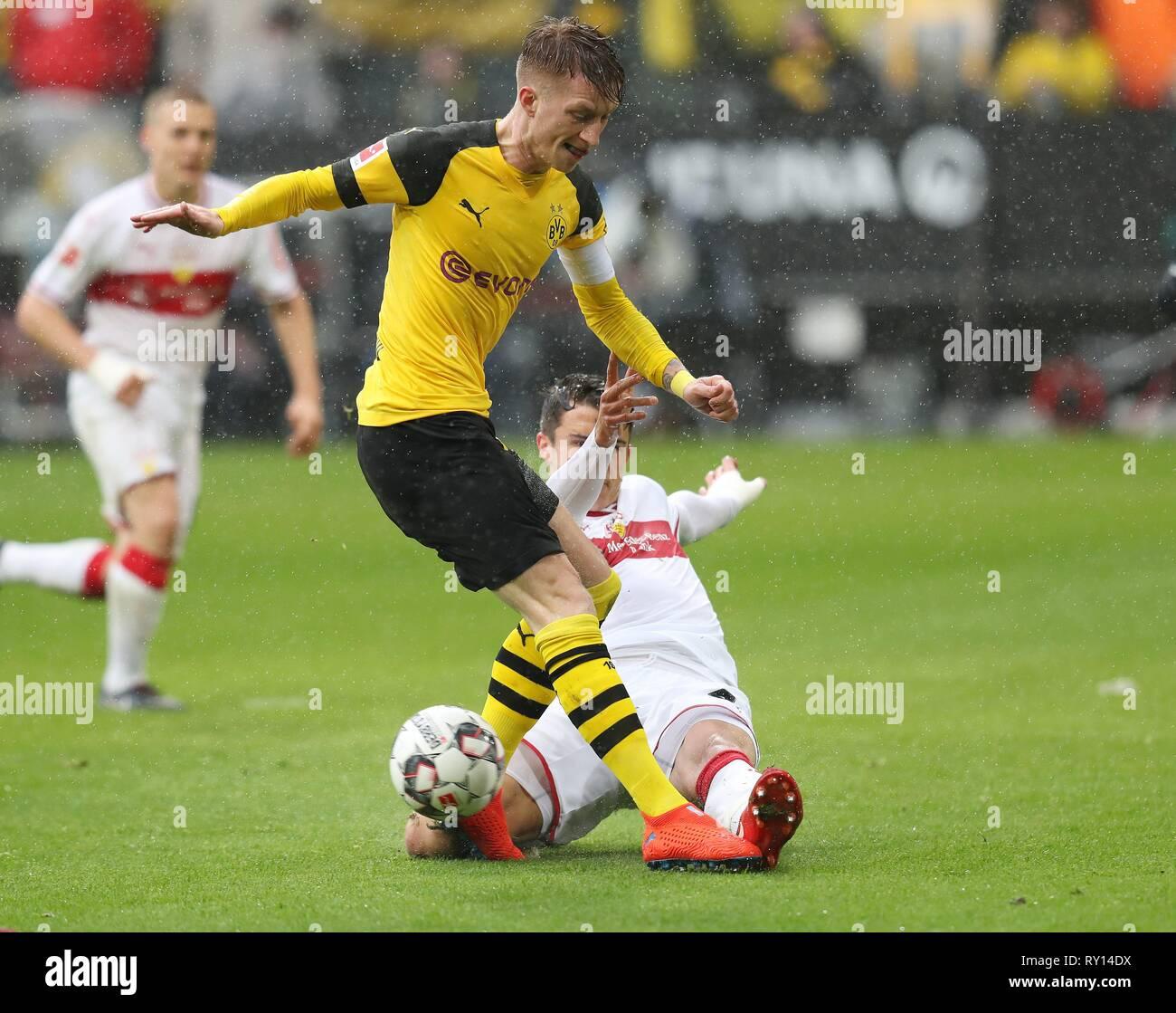 Dortmund, Deutschland. 09th Mar, 2019. firo: 09.03.2019, Football, 2018/2019, 1.Bundesliga BVB Borussia Dortmund - VfB Stuttgart 3: 1 Marco Reus, duels | Credit: dpa/Alamy Live News - Stock Image