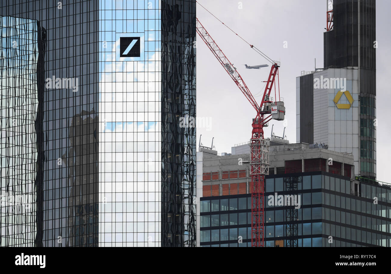 11 March 2019, Hessen, Frankfurt/Main: The head offices of Deutsche Bank (l) and Commerzbank (back right) are joined by a telephoto lens. According to the Federal Finance Minister, both financial institutions are sounding out the current situation. Photo: Arne Dedert/dpa - Stock Image