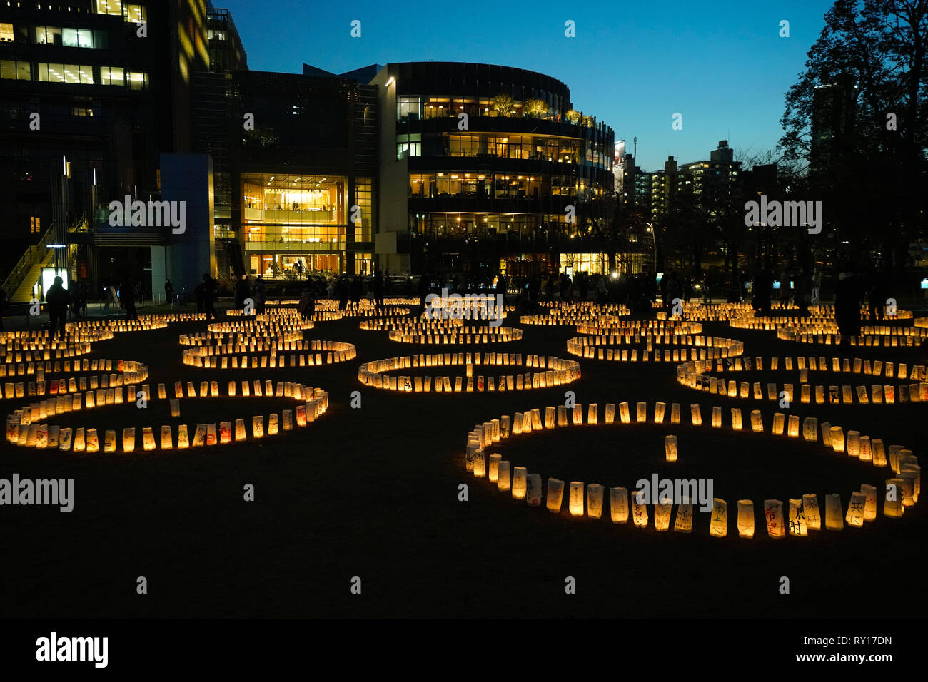 Tokyo, Japan. 11th Mar, 2019. Candles with messages dedicated to the people affected by the Japan March 11 Great East Japan Earthquake is seen at a park in Tokyo on March 11, 2019, Tokyo, Japan. This year marks the 8th anniversary of the 2011 disaster. Credit: AFLO/Alamy Live News - Stock Image